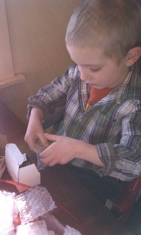Our grandson bagging brass screws for gate signs!  -
